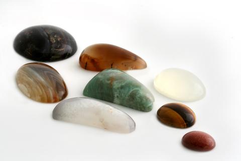 assortment of diamonds and gems