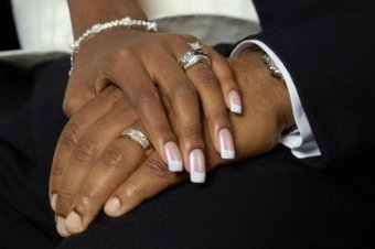 Just Married holding hands